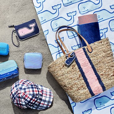 An assortment of blue white and red beach bags